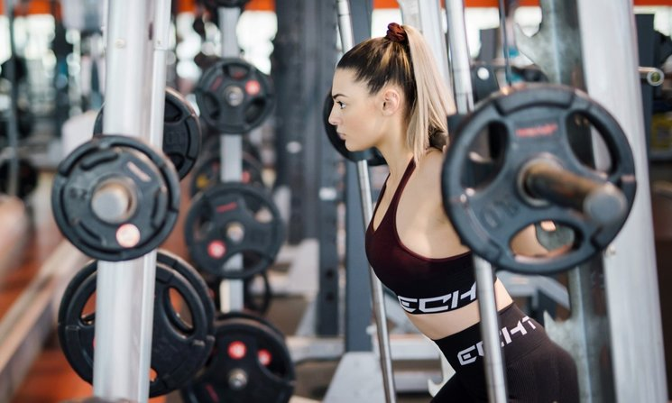 A woman lifts weights in the Manawatū gym