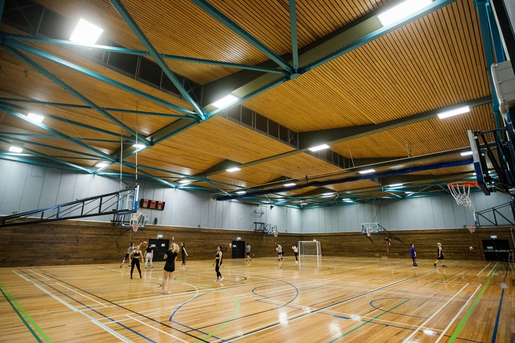Students play indoor sports on the indoor courts