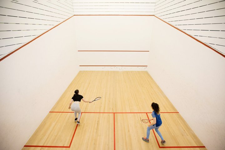 Female squash-players in the indoor court