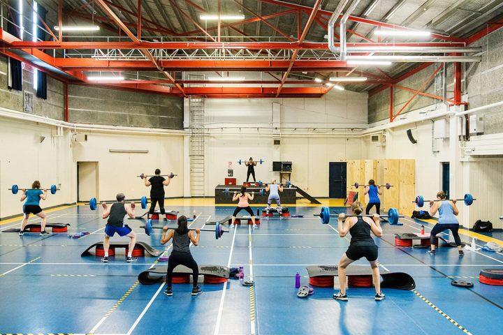 Group fitness class in progress in the multi-purpose indoor Activity Centre