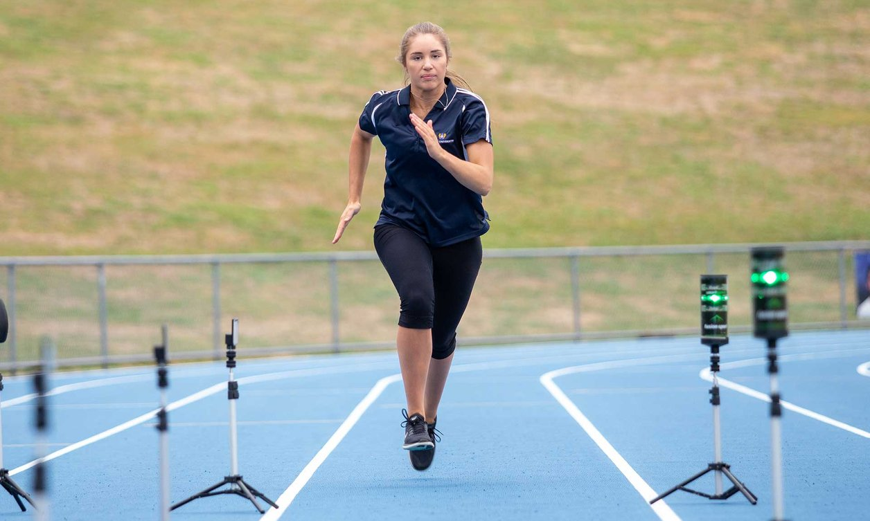 A Massey student running track at the Manawatu campus