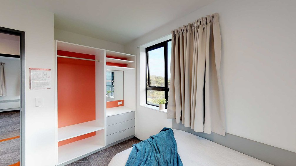 Matipo, Titoki and Tānekaha apartments' single bedroom with drawers and wardrobe