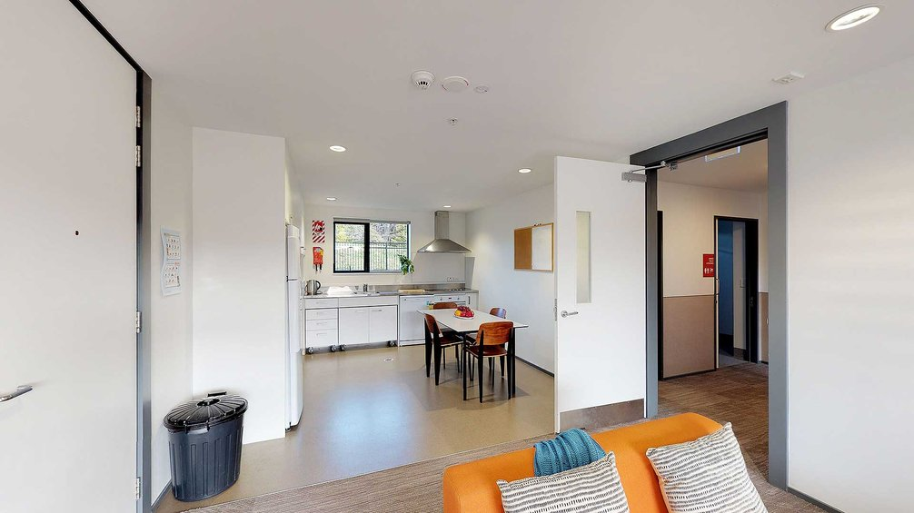 Matipo, Titoki and Tānekaha apartments' kitchen with small dining table and chairs