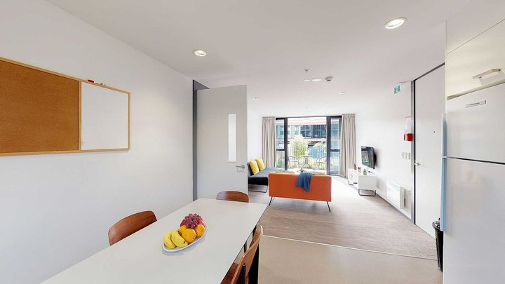 Matipo, Titoki and Tānekaha apartments' kitchen with dining table and chairs