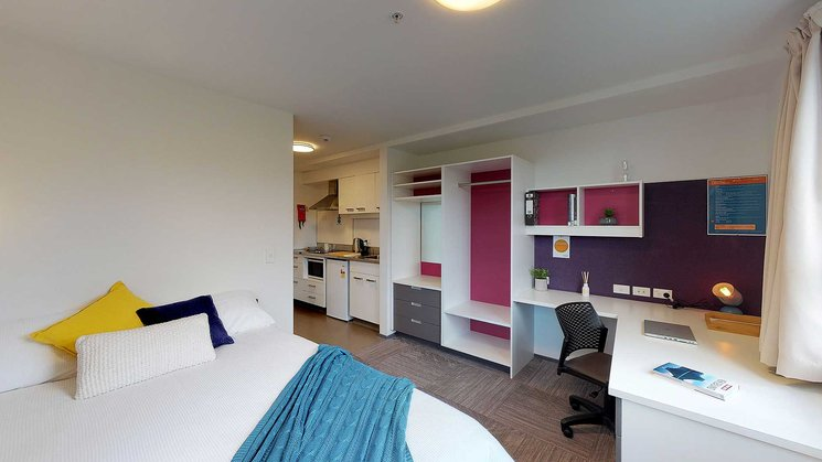 Studio Unit with double bed, study area and a kitchenette