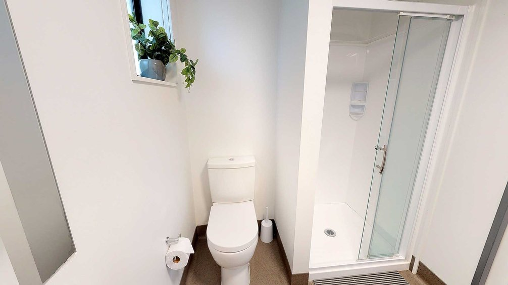 Studio Unit bathroom with toilet and shower