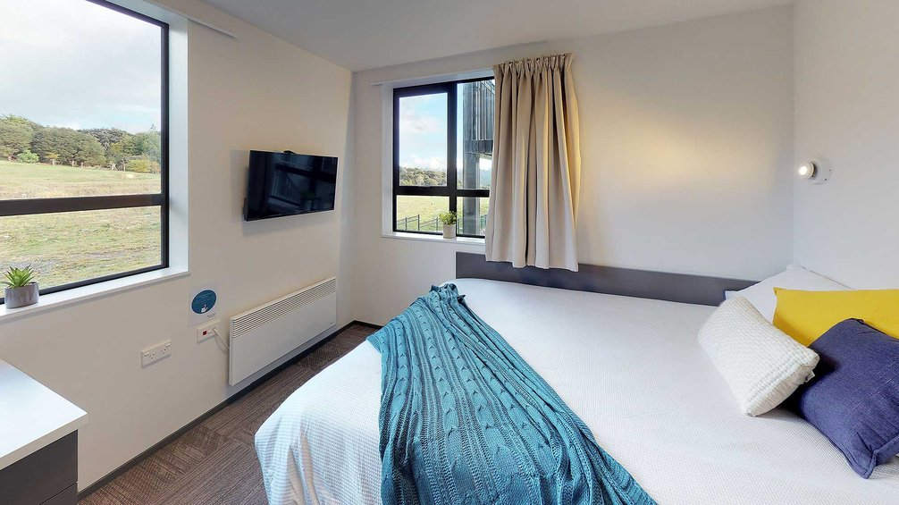 Studio Unit with double bed, wall mounted TV, and rural views
