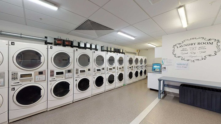 Te Rito laundry with many washing machines and a bench seat