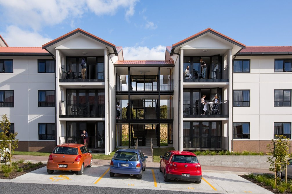 Row of Matipo, Titoki and Tānekaha apartments with cars parked outside