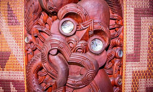 Close-up of a traditional Maori wooden carving