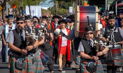 Bagpipe players leading graduation procession in Auckland