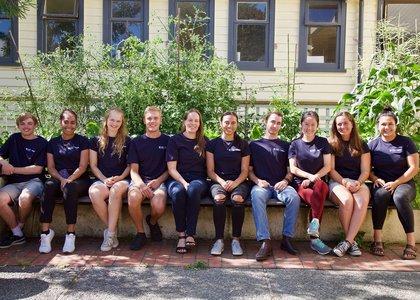 Scholars@Massey peer scholars, wearing matching navy T-shirts
