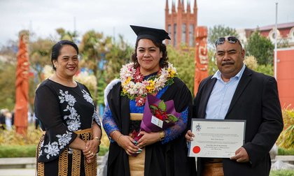 Pacific student with family at graduation