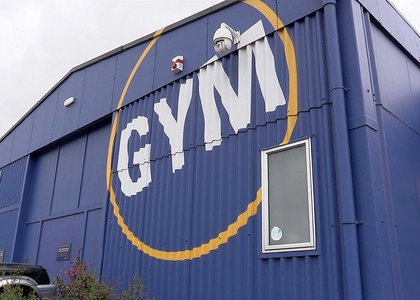 Exterior of blue Wellington Recreation Centre with the word Gym written on it
