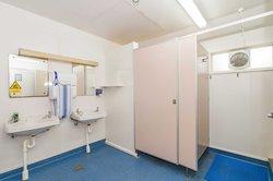 Interior of Kiwitea accommodation's beige bathroom