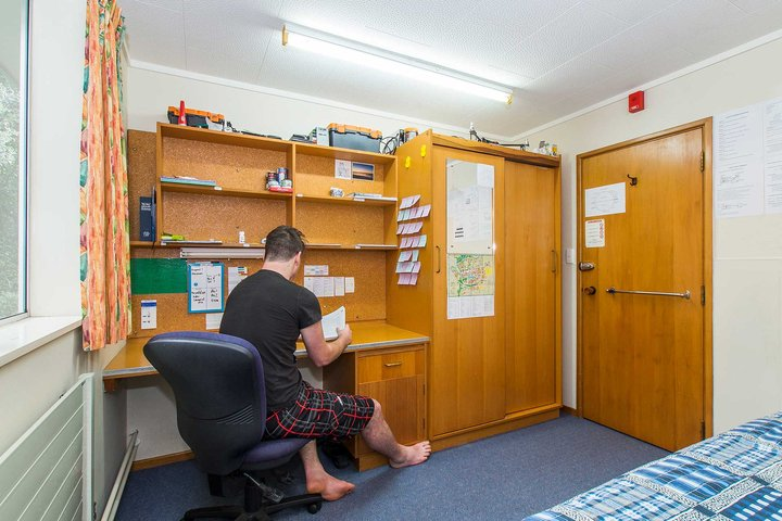 Student sitting at desk in Kiwitea bedroom