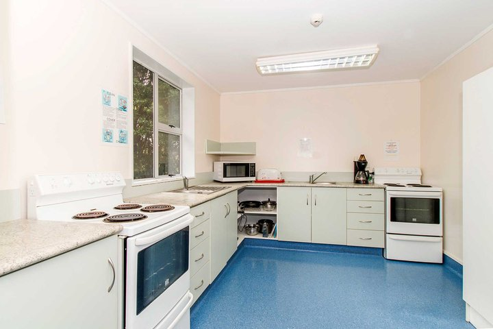 Interior of Kiwitea accommodation kitchen with two ovens