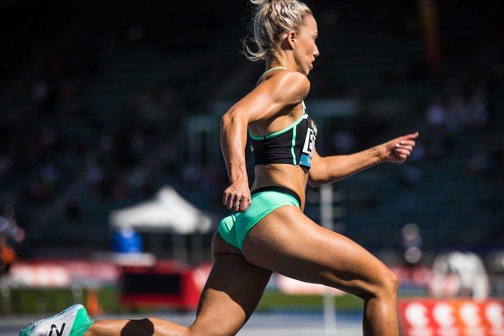 Olivia Eaton running on a track
