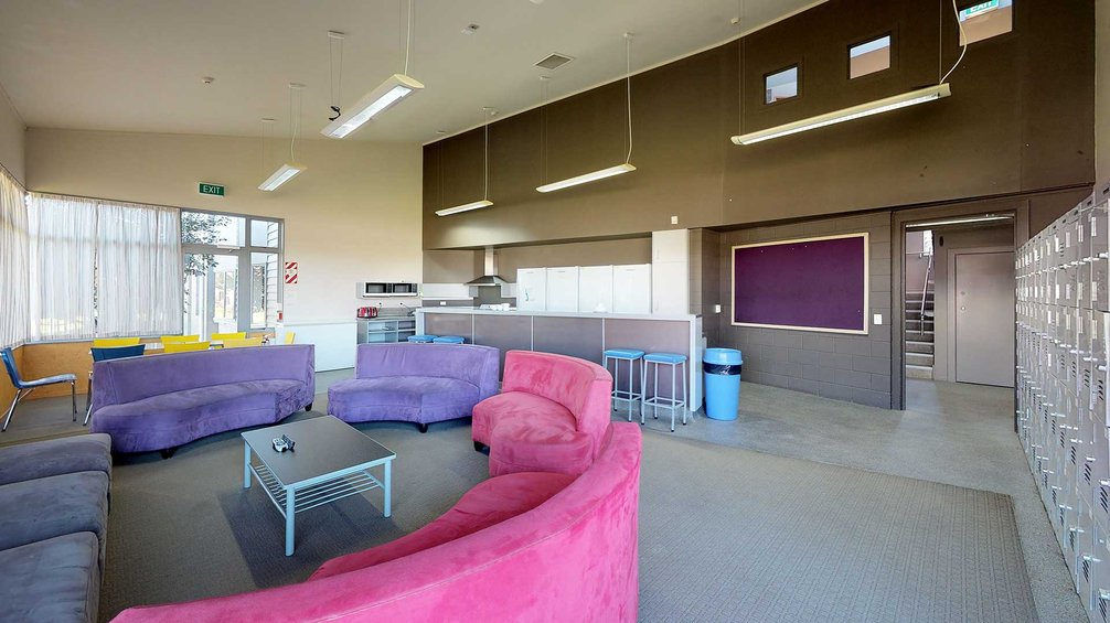 Matai, Miro, Tawa and Totara Halls' lounge area with a kitchenette and couches arranged in a semi-circle