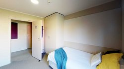 Matai, Miro, Tawa and Totara Halls' single bedroom with a bed and a wardrobe