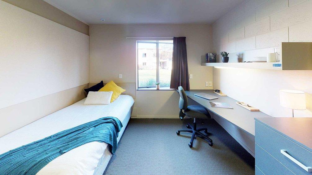 Matai, Miro, Tawa and Totara Halls' single bedroom with a bed, desk and chair