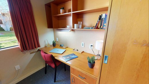 Interior of Ruahine and Tararua apartments' single bedrooms with built-in study desk and chair