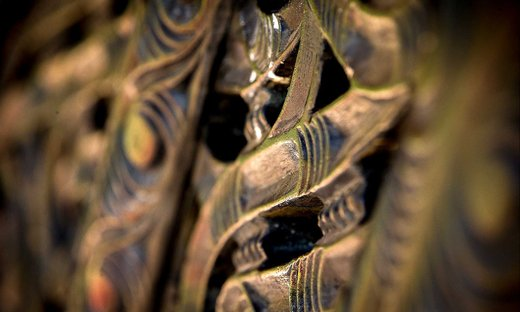 Close-up of a brown traditional Māori wood carving