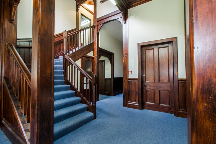 Interior of Craiglockhart Hall showing entrance and grand wooden staircase
