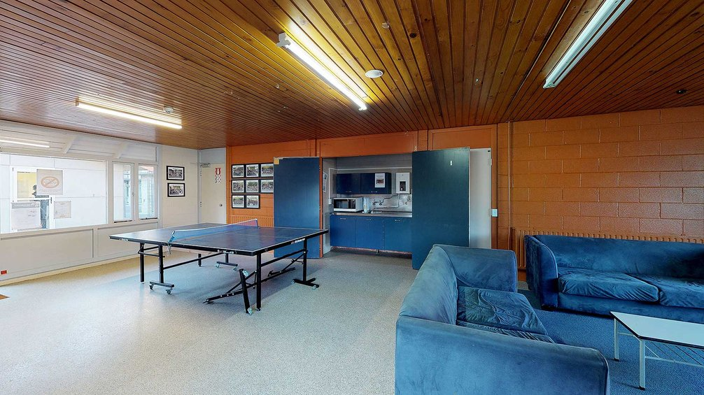 Interior of City and Egmont Courts' lounge with kitchenette, table tennis table and couches