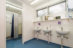 Interior of Craiglockhart Hall showing shower cubicles and hand basins