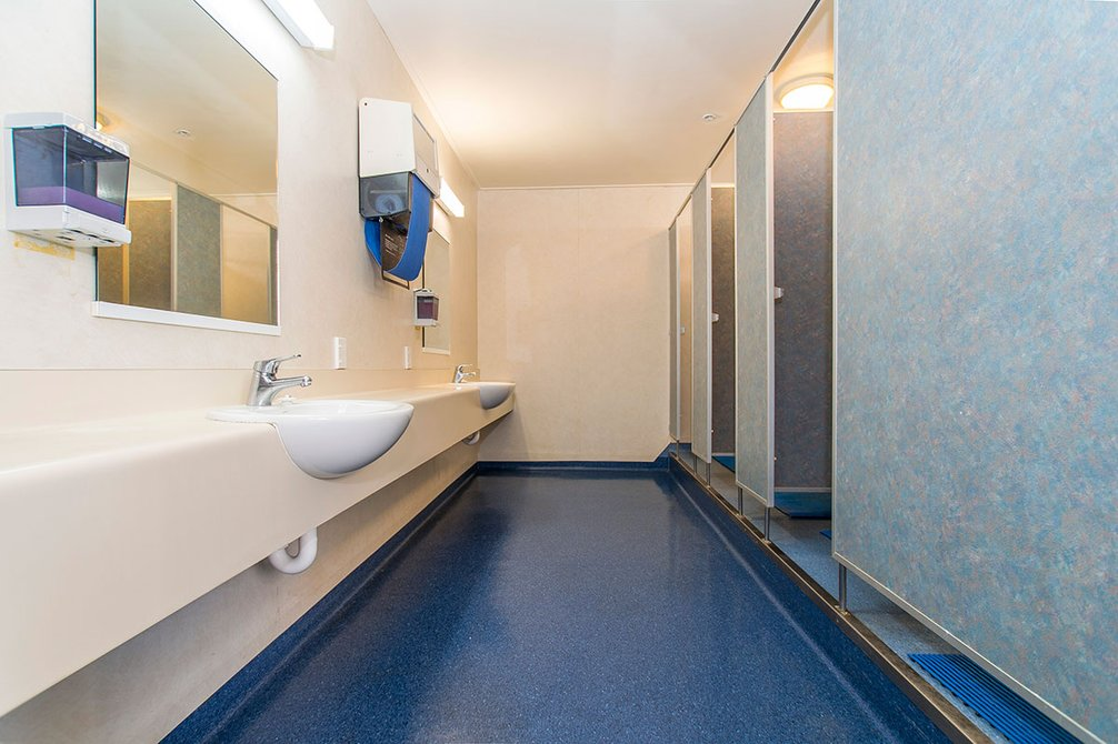Bathroom in McHardy Hall with hand basins and several showers
