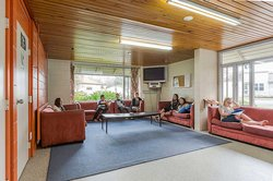 Interior of the Kairanga and Rotary Courts common room with students sitting and lying on couches