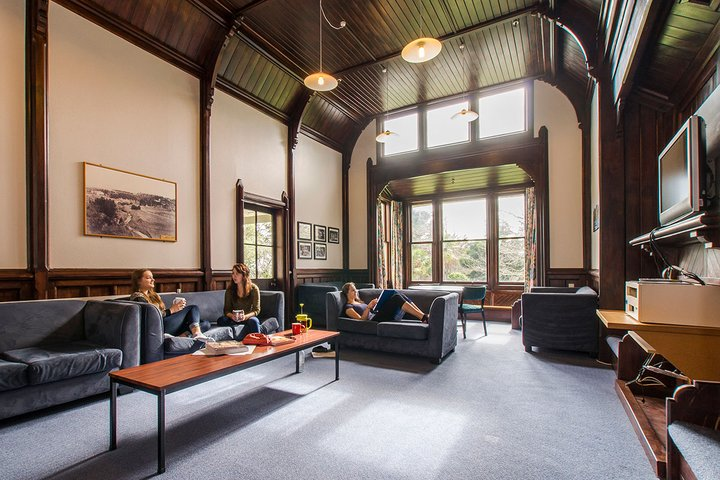 Interior of Craiglockhart Hall's large lounge with students sitting on couches
