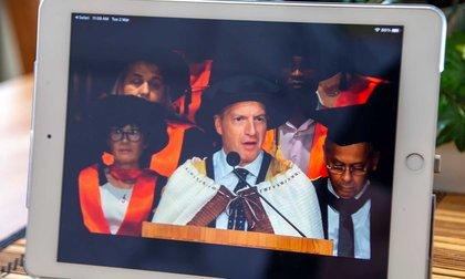 Close-up of a tablet screening graduation livestream