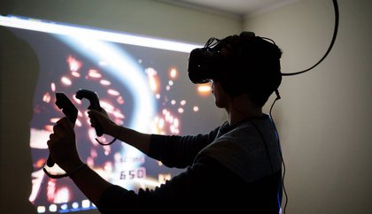 A student using virtual reality (VR) equipment