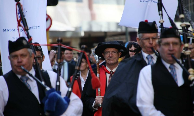 Bagpipe players in graduation procession